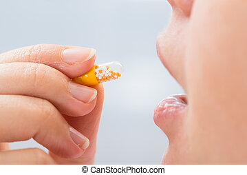 Person Eating Medicine - Close-up Photo Of Person Taking...