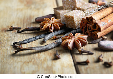 Vanilla, cinnamon, cocoa, anise and cloves on wooden table