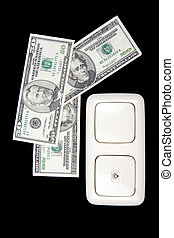electric switch and money on dark background
