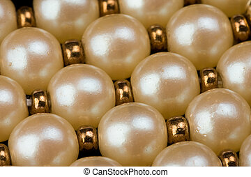 pearl necklace - detail of pearl necklace on dark background
