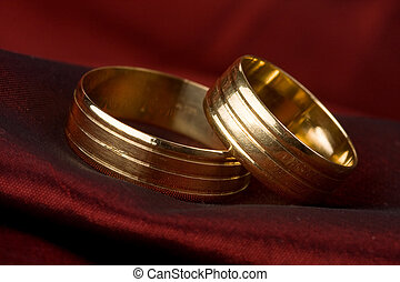 wedding ring on red background