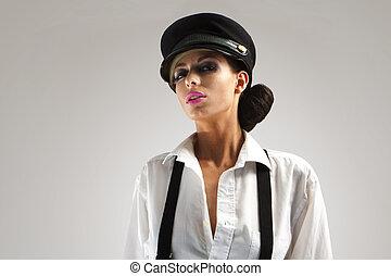 sexy capitan - Portrait of beautiful teenager with peak-cap...