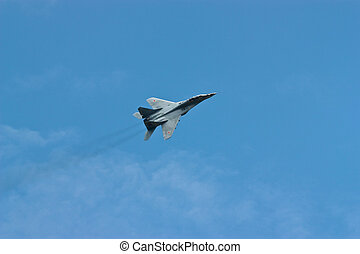 Military Jet - Jet fighter in flight against the dark blue...