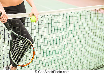 tennis background - young woman with yellow ball and racket...