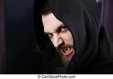 Angry vampire with red eyes - Male vampire ready to attack...
