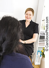 Customer consultation at body treatment clinic