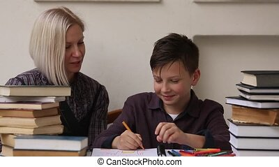 Tutor teaches a school Boy with his studies.