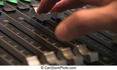 Audio engineer adjusting faders - technician using audio...