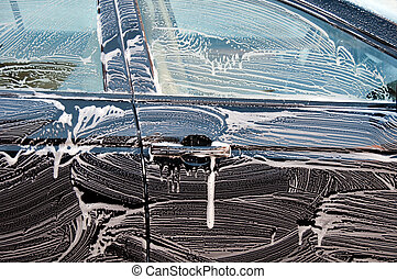 capture of a car close up getting washed - photo capture of...