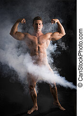 Totally naked male bodybuilder with smoke hiding genitalia,...