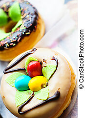 Sweets - bright donuts on the wooden background