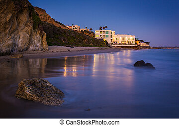 Modern house on the beach at night, seen from El Matador...
