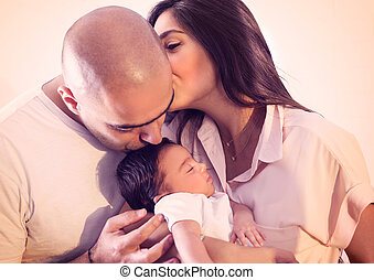 Happy family portrait, beautiful young parents holding their...