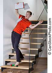 Slipping on a toy - Young inattentive man slipping on stairs...