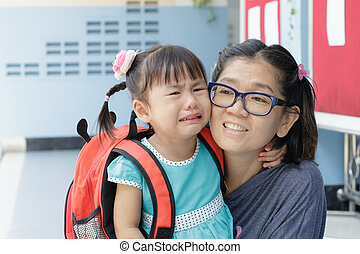 children and mother crying first day go to pre-kindergarten...