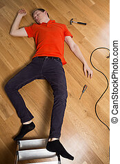 Accident at home - Young man on the floor having dangerous...