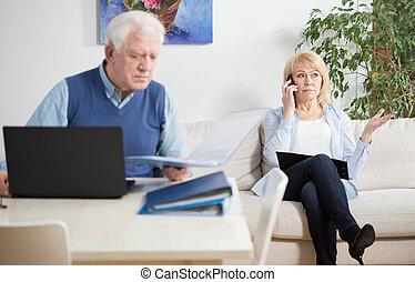 Elder people working at home - Elder and busy people working...