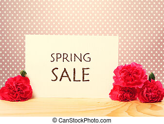 Spring Sale card with pink carnations over polka dots...