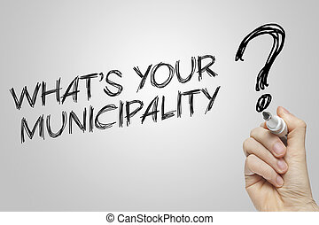 Hand writing whats your municipality on grey background