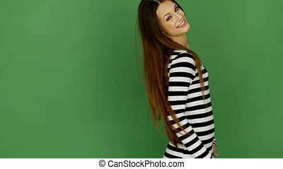 Woman In Stripy Top - Attractive young woman smiling and...