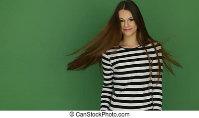 Woman In Stripy Top - Attractive young woman posing in a...