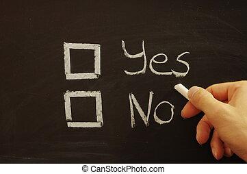 vote yes or no written on chalkboard or blackboard...