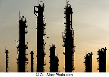 Sunset over Natural Gas Plant - The sun going down and bring...