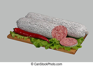 Salami on wooden board. - Smoked sausage with paprika and...