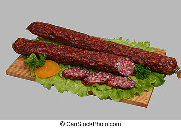 Smoked sausage on wooden board 2 - Smoked sausage with...