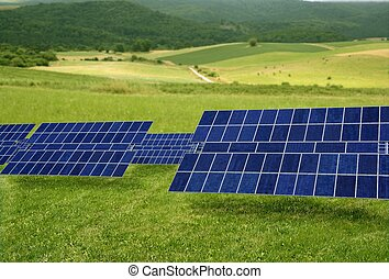 Clean electric energy solar plates in meadow
