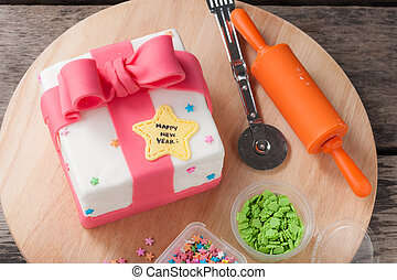 Fondant cake - New year present concept fodant cake on wood...