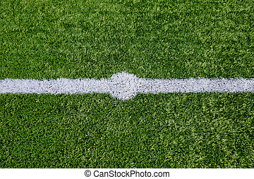 Straight white chalk line marking on grass background.
