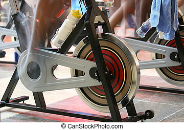 spin the bike - blur motion of people having a training...