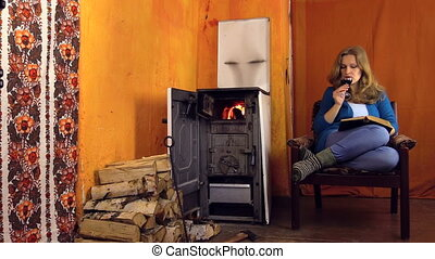 woman red wine book stove