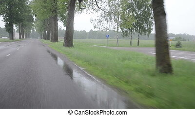 rain car windscreen - rain falling on windscreen and...
