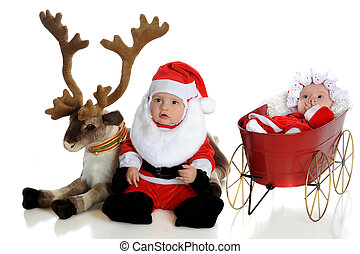 Mr and Mrs Claus - An adorable baby santa with his reindeer...