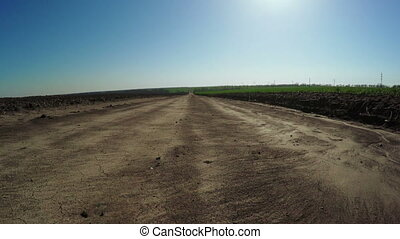Unpaved road - Section between dirt road and field