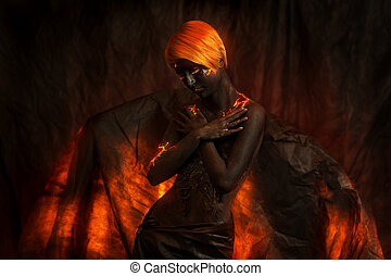 Portrait of a beautiful woman with body painting of volcano
