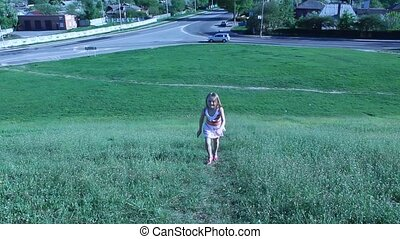 little girl running up to the hill