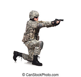 soldier shoots a gun standing on his knee