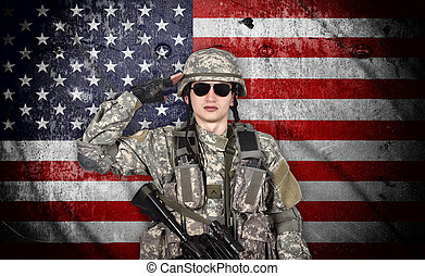 soldier salutes the American flag on the background