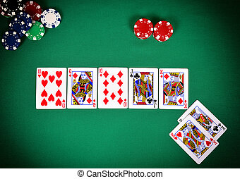 poker game concept - chips and cards on green table, poker...