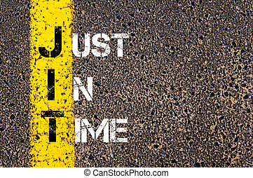 Business Acronym JIT - Just In Time. Yellow paint line on...