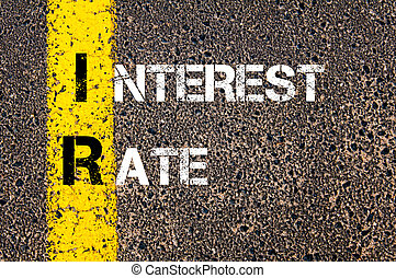 Business Acronym IR - Interest Rate Yellow paint line on the...
