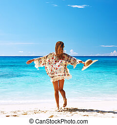 Woman with sarong on beach at Seychelles - Woman with sarong...