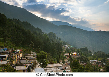 Sunrise over McLeodGanj, the residence town of Dalai Lama,...