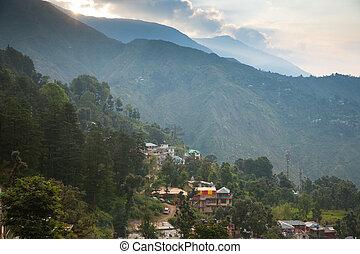 Sunrise over McLeodGanj, the residence town of Dalai Lama,...