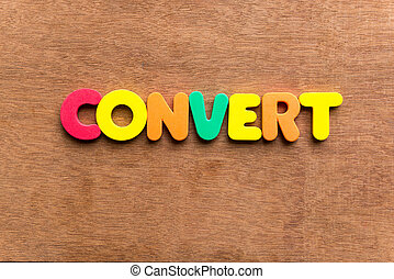 convert colorful word on the wooden background