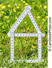 White house outline in the grass for real estate