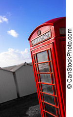 Beach phonebox - BT GPO red telephone box on a beach, public...
